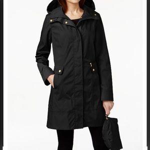 Black Cole Haan packable raincoat